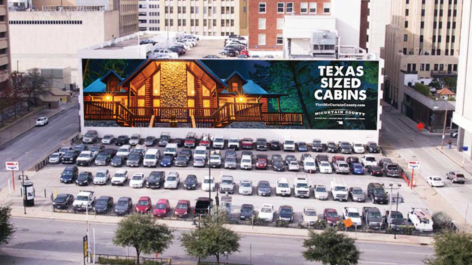 Award-winning, gigantic McCurtain County Tourism Authority cabin wallscape in Dallas, Texas